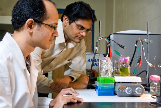 Ramaraja Ramasamy,right, and Yogeswaran Umasankar work together to capture energy created ...